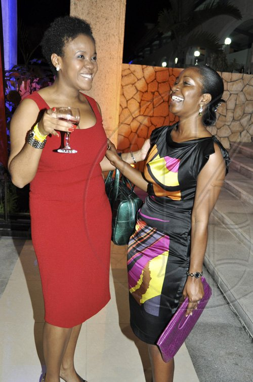 Janet Silvera Photo   The Jamaica Pegasus' Kerrie-Ann Tucker (left) and Digicel's Jacqui Burrell at the opening of Caribbean Marketplace at the Montego Bay Convention Centre last Sunday night.