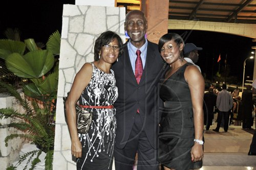 Janet Silvera Photo   Dr. Garfield Munroe of Kool Runnings Waterpark, Negril and his wife Margaret (left) and daughter Shari at the opening of Caribbean Marketplace at the Montego Bay Convention Centre last Sunday night.