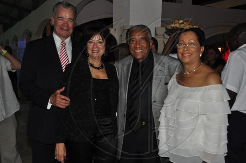 Janet Silvera Photo   From L- Director General of the Caribbean Hotel and Tourist Association (CHTA), Alec Sanguinetti and his wife Flavia, pose with friends Lady Betty Hopkins and husband Sir Royston of Grenada at the opening of Caribbean Marketplace at the Montego Bay Convention Centre last Sunday night.
