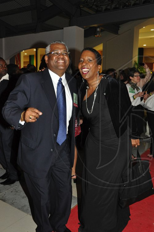 Janet Silvera Photo   David Sheilds enjoying his last days at the Jamaica Tourist Board as he makes his transition to Island Routes found time to dance with Jamaica's lady of soul, Karen Smith  the opening of Caribbean Marketplace at the Montego Bay Convention Centre last Sunday night.