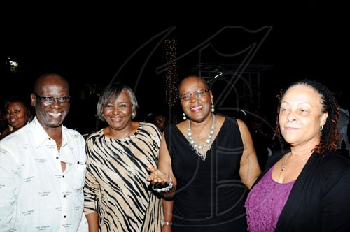 Winston Sill / Freelance Photographer Kingston's Mayor Desmond McKenzie is surrounded by beauty as he lymes with (from second left) wife Marcia, Audrey Hinchcliffe and Doreen Frankson.  *************************************************************************** and host Appreciation Party, held at Eden Gardens, Lady Musgrave Road on Thursday night December 30, 2010.