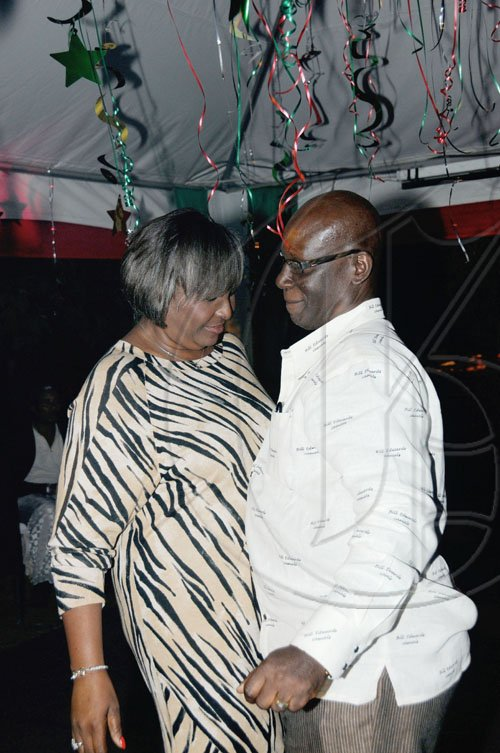 Winston Sill / Freelance Photographer Desmond McKenzie and wife Marcia 'get on bad'.  ****************************************  host Appreciation Party, held at Eden Gardens, Lady Musgrave Road on Thursday night December 30, 2010.