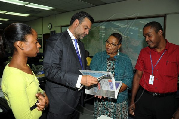 Ian Allen/Photographer Jesus Silva bids farewell to Gleaner Editorial staff.
