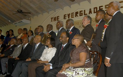 Contribution                                                                                                                                                                                                                                                                               Governor-General, His Excellency the Most Hon. Sir Patrick Allen (seated, fourth left) and Lady Allen (third left), with recipients of the Governor General's Achievement Awards for the County of Cornwall, at a function, held in Parottee, St. Elizabeth, on August 25.