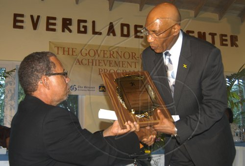 Contribution                                                                                                                                                                                                                                                                               Principal of the Black River High School, the Reverend Dr. Barrington Buchanan (left), accepting his award from Governor-General, His Excellency the Most Hon. Sir  Patrick Allen, at a presentation ceremony, held in Parottee, St. Elizabeth, on August 25.