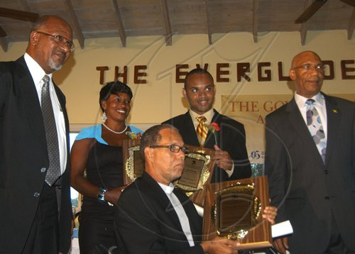 Contribution                                                                                                                                                                                                                                                                               Governor-General, His Excellency the Most Hon. Sir Patrick Allen (right), with Acting Custos of St. Elizabeth, Wilfred Nembhard (left), and some of the recipients of the Governor General's Achievement Awards for the County of Cornwall, at a function, held in Parottee, St. Elizabeth, on August 25.  In back row (from second left) are:  Janell Wright and Roger Bent.  In foreground is Principal of the Black River High School, the Revered Dr. Barrington Buchanan.