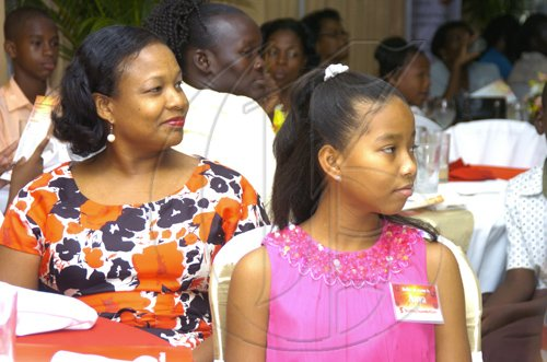 Gladstone Taylor / Photographer  Jacqueline Chuck and daughter Anya Chuck as seen at the Scotia Jamaica Foundation Shining Star Scholarship awards luncheon on August 26, 2010
