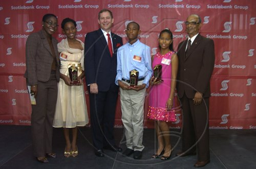 Gladstone Taylor / Photographer  Left to right: Joylene Griffiths Irving,  Kaydian Farquharson, Wayne Powell, Daniel Lawla,  Anya Chuck and  Bruce Bowen as seen at the Scotia Jamaica Foundation Shining Star Scholarship awards luncheon on August 26, 2010