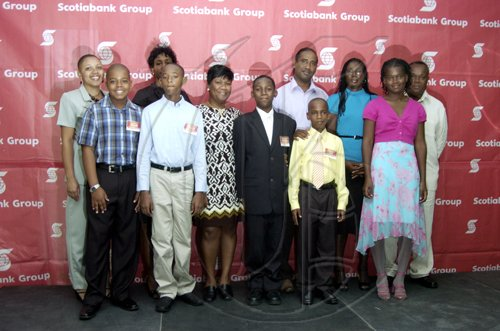 Gladstone Taylor / Photographer  front row; left to right : Russel, Gordon, Daniel Lawla, Matthew campbell, Kyle Sahadath, shania Owens  Backrow; left tor ight: Doreen Cushnie, Althea Lawla, Georgia Chamberlian, Jushua Sahadath, Valerie Warmington, Winston Owens  as seen at the Scotia Jamaica Foundation Shining Star Scholarship awards luncheon on August 26, 2010