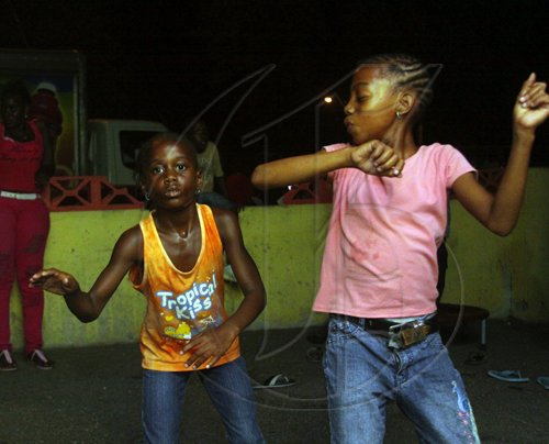 Anthony Minott/Freelance Photographer These girls dance the evening away during a back-to-school project instigated by Councillor for the Independence City Division, Keith Blake.