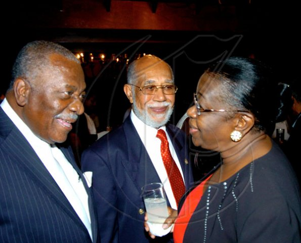 Winston Sill / Freelance Photographer Conferment of the Order of the Civil Merit of Spain on Edmund Bartlett, Minister of Tourism, at a reception hosted by Ambassador Jesus Silva and Sara Silva, held at Norbrook Road on Friday night May 7, 2010. Here are  Godfrey Dyer (left); Lionel Reid (centre); and Dorothy Carter-Bradford (right).