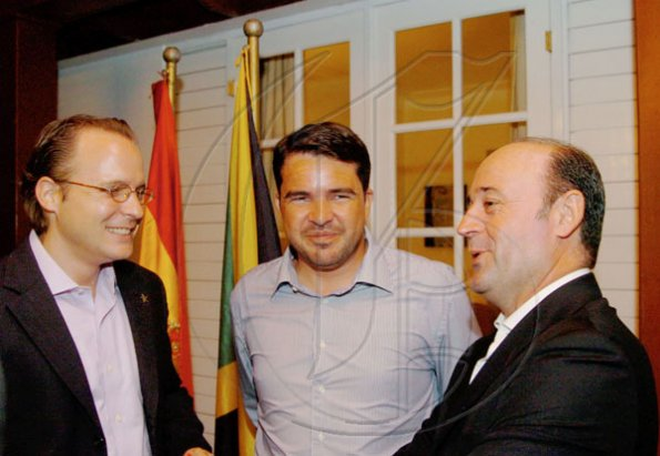 Winston Sill / Freelance Photographer Conferment of the Order of the Civil Merit of Spain on Edmund Bartlett, Minister of Tourism, at a reception hosted by Ambassador Jesus Silva and Sara Silva, held at Norbrook Road on Friday night May 7, 2010. Here are  Philipp Hofer (left), Managing Director, Iberostar Resort; Rafael Matas (centre), of Excellence Group; and Miguel Angel Cano (right), Managing Director, Gran Bahia Principe.