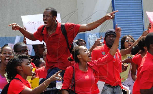 Ricardo Makyn/Staff Photographer. University Students protesting against Minister of Education Andrew Holness because of the withdrawal of a subsidy to Tertiary level Students  on Tuesday 13.4.2010