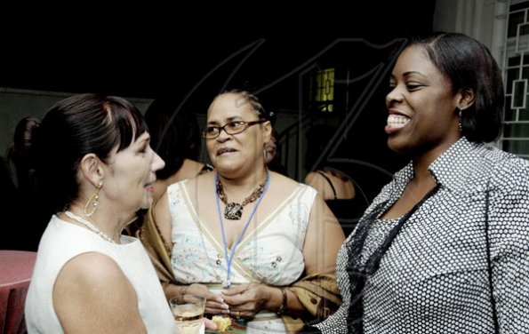 Winston Sill / Freelance Photographer Cathy Hallihan (left) welcomes delegates Desiree Edghill (centre) of Guyana and Vicki Marshall, co-chair of the Caribbean-Canada Emerging Leaders Dialogue.      (CCELD), held at Seymour Avenue on Tuesday night June 7, 2011.