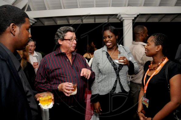 Winston Sill / Freelance Photographer Anthony Bell (second left) raps with Caribbean-Canada Emerging Leaders Dialogue delegates (from left) Dylan Williams, Vicki Marshall and Chandra Williams.  Canadian High Commissioner, Stephen Hallihan and his wife Cathy host a Reception for delegates to the Caribbean-Canada Emerging Leaders Dialogue (CCELD), held at Seymour Avenue on Tuesday night June 7, 2011.