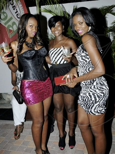 Winston Sill / Freelance Photographer From left: Michelle Smith, Nadrika Blake and Kaniggia Buckle worked our camera's lens.   Caribbean Fashion Week (CFW) Opening Reception, held at Spanish Court Hotel, New Kingston on Thursday night June 9, 2011.