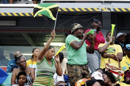 Aderian Frater photo Jamaican fans celebrate another success on the final afternoon of the LIME CARIFTA Games, at the Montego Bay Sports Complex, St James, yesterday.