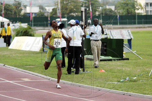Adrian Frater photo Orane Wint is alone at the finish line as he takes gold for Jamaica in the boys' Under-20 5000 metres, on yesterday final afternoon of the LIME CARIFA Games at the Montego Bay Sports Complex, St James.