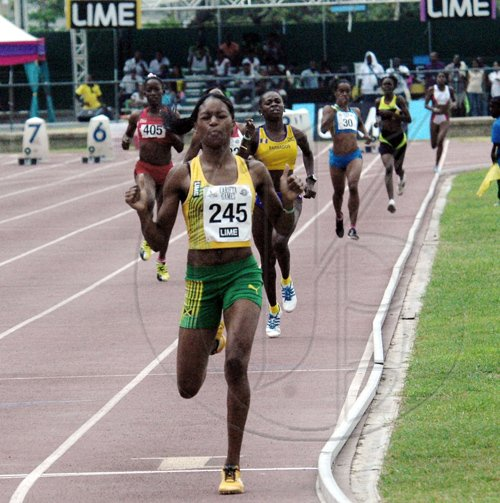 Jamaica's Peta Gay Williams speeds to the finishing line to win yet another gold medal for Jamaica at the 40th CARIFTA Games, which was staged in Montego Bay over the Easter weekend.                                                        -Adrian Frater: Photo