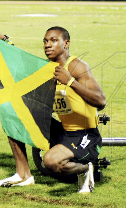 Yohan Blake         Photo by Anthony Foster Jamaica's Yohan Blake poses after stopping the clock in a scintillating, record-breaking time of 10.11 seconds at the CARIFTA Games in the Turks and Caicos on Saturday evening. Blake, 17,  broke Raymond Stewart's 10.19 seconds, which stood for 23 years as the national junior 100-metre record.