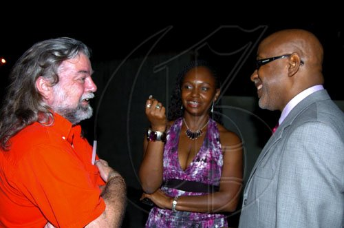 Winston Sill / Freelance Photographer Pulse International CEO Kingsley Cooper (right) hangs with Jonathan and Paula Surtees at the Launch of CFW 10th Anniversary, held at Studio 38, Trafalgar Road on Tuesday February 9, 2010.
