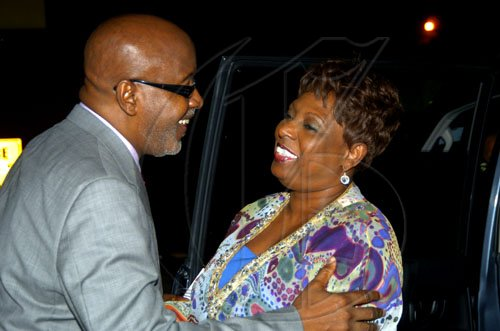 Winston Sill / Freelance Photographer Kingsley Cooper greets Sports Minister Olivia 'Babsy' Grange at  the launch of CFW 10th Anniversary, held at Studio 38, Trafalgar Road on Tuesday February 9, 2010.
