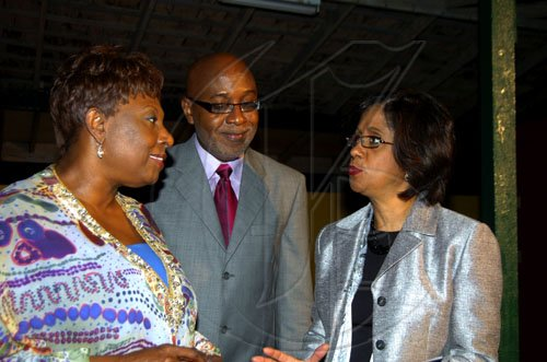 Winston Sill / Freelance Photographer Sports Minister Olivia 'Babsy' Grange (left) hobnobs with Pulse boss Kingsley Cooper and Sancia Bennett-Templar at the Launch of CFW 10th Anniversary, held at Studio 38, Trafalgar Road on Tuesday February 9, 2010.