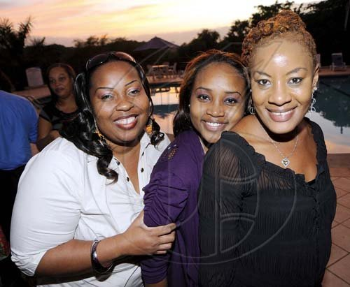 Rudolph Brown/Photographer From left: Lucy Schloss-Smith, Sherece Moulton and Andrea Clarke show their radiant smiles.  **************************************************************************************************************at the St. Catherine Co-operative Credit Union Christmas awards luncheon at Caymanas Golf and Country Club on Wednesday, December 22-2010