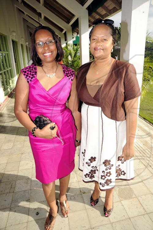 Rudolph Brown/Photographer Genaral Manager Sandra Thompson (right) and  Yvonne Purcellarrive for the luncheon.  ************************************************************ at the St. Catherine Co-operative Credit Union Christmas awards luncheon at Caymanas Golf and Country Club on Wednesday, December 22-2010
