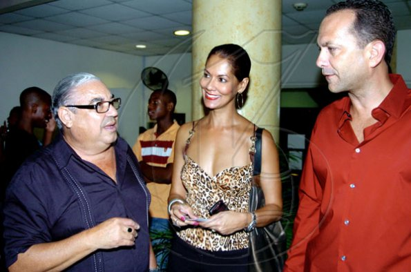 Winston Sill / Freelance Photographer Dean of the Consular Corps of Jamaica Robert MacMillan (left) chats with William Tavares-Finson and wife Sandy at the premiere of the movie Eclipse, an installment of the Twilight Saga at Carib Cinema, Cross Roads on Tuesday night July 6, 2010..