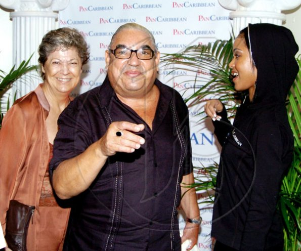 Winston Sill / Freelance Photographer The always jovial Robert MacMillan is up to his tricks again with Marie Sigurdsson (left) and PanCaribbean's Camille Tenn.   Consular Corps of Jamaica host Reception for  Premiere of the movie Eclipse, held at Carib Cinema, Cross Roads on Tuesday night July 6, 2010..