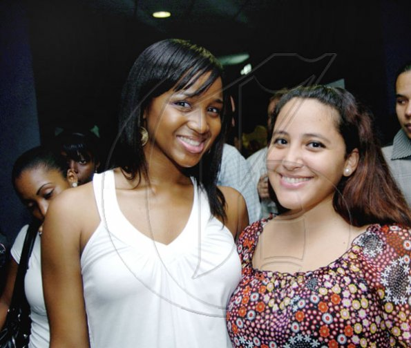 Winston Sill / Freelance Photographer Gal pals Tiffany Watson (left) and Mariam Wahbi couldn't miss this one.  Consular Corps of Jamaica host Reception for  Premiere of the movie Eclipse, held at Carib Cinema, Cross Roads on Tuesday night July 6, 2010..