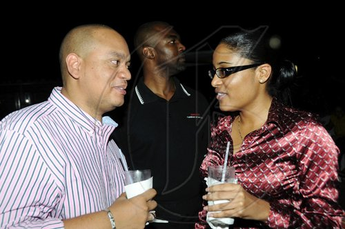 Rudolph Brown/Photographer Leighton Davis has a word with Ava-Marie Wright.  *************************************************************************** at the Wealth Magazine and Scotia DBG Investments Chicks and Balances Poolside party at Terra Nova Hotel in Kingston on Thursday, August 19-2010