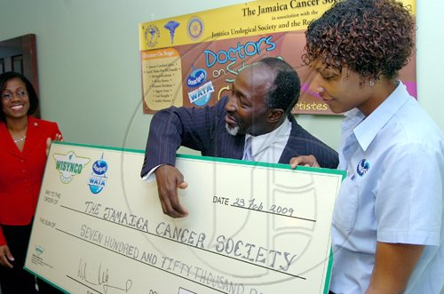Rudolph Brown/Chief Photographer Tamara Ward, (right) Wisynco, Title sponsor presents a cheque for $750,000 to Lincoln Robinson, (centre) Board member of Jamaica Cancer Society and Chairman, Planning committee,  and Carol Blair, (left) Administrative Manager, Jamaica Cancer Society speaks to members of the media at the Cancer Society, Doctors on Stage for Cancer media launch and sponsors presentation at the Society Office in Kingston on Monday, February 23-2009