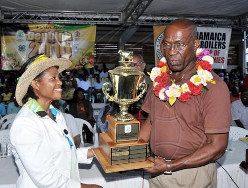 Contrbuted                                                                            Her Excellency the Most Hon. Lady Allen, presents the 2010 Champion Farmer trophy to  Errol Pickney, yesterday (August 1) at the Denbigh Agri- Industrial Show in May Pen, Clarendon.