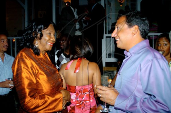 Winston Sill / Freelance Photographer Mare Seeberan (left), have something pleasant to discuss. ***************************************************************  Christopher Levy.National Commercial Bank (NCB) host Dinner Party, featuring the Nobu Restaurants menu, held at Strawberry Hill, St. Andrew on Thursday night April 1, 2010.