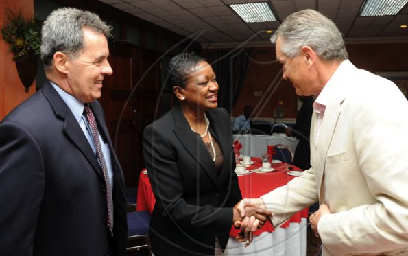 Rudolph Brown/Photographer Minna Israel, (centre) president of RBTT Bank Jamaica Limited greets Hemi Mitic, (right) Labour Relations Consultant member CCELD Steering Committee and Stephen Hallihan, High Commissioner of Canada to Jamaica, at Scotiabank and CCELD launches Caribbean Canada Emerging Leaders' Dialogue, CCLED Conference 2011 at Courtleigh Hotel in New Kingston on Tuesday, August 17-2010.