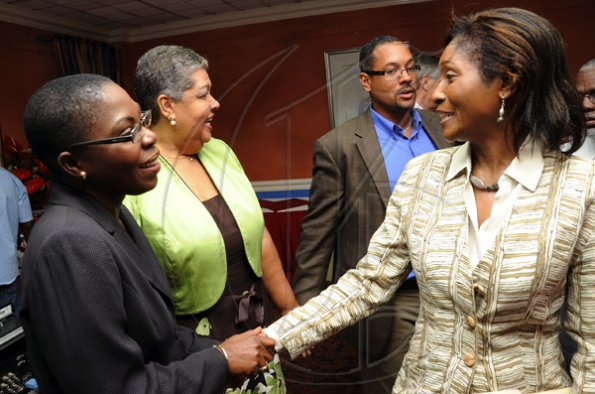 Rudolph Brown/Photographer Joylene Griffiths Irving, (left) Director, Public and Corporate Affairs greets Serena Joaquim of Courtleigh Hotel, Aloun Ndombet Assamba, (second left) Alumni and Attorney at Law and Christopher Barnes, Assistant to Managing Director of the Gleaner Company at Scotiabank and CCELD launches Caribbean Canada Emerging Leaders' Dialogue, CCLED Conference 2011 at Courtleigh Hotel in New Kingston on Tuesday, August 17-2010.