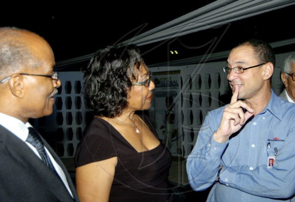 "Group Chief Operating Officer of GraceKennedy, Don Wehby (right) engages Sir Kenneth and Lady Hall in conversation as they came out in support of First Global's customer appreciation event, ""A Touch of Culture"" at Jamaica Pegasus, last Thursday.