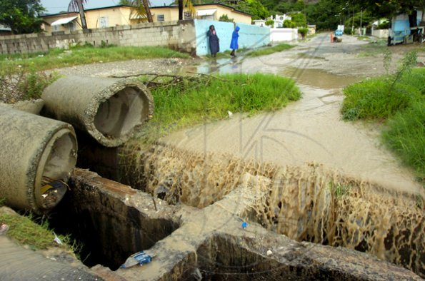 Norman Grindley/Chief Photographer A broken damaged drain along Stellar Road in Harbour View, St Andrew collects water from yesterday's heavy rainfall.