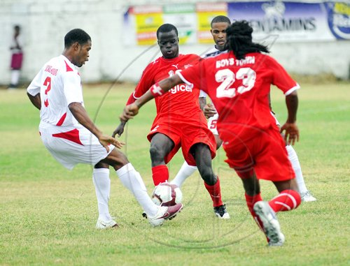 Ricardo Makyn/Staff Photographer. St Georges Sports Club's Dwayne Holmes (left) and Boys' Town's Marvin Morgan (second left) challenge for the ball, while Boys' Town's Romondo Johnson (right) and St Georges' Ricardo Taylor respond, during the Digicel Premier League football match at Collie Smith Drive yesterday. Boys' Town won 4-2.   Action from the Boys Town vs St Georges match on the openning day of the Digicel Premiere League on Sunday 29.8.2010.