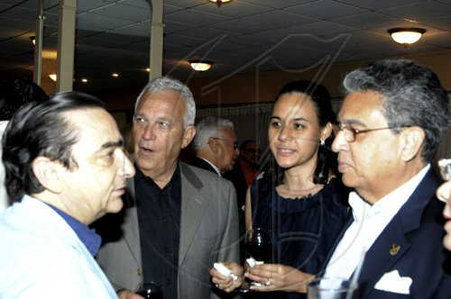 Winston Sill / Freelance Photographer Engrossed in deep conversation are (from left) Chilean Ambassador Alfredo Garcia (left) Charles Johnston, Lisa Johnston and Bindley Sangster. ******************************************************* German Ambassador host German Day of Unity Reception, held at the Jamaica Pegasus Hotel, New Kingston on Monday night October 4, 2010.