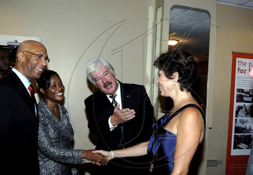Winston Sill / Freelance Photographer German Ambassador Jurgen Engel (second right) introduces Governor General Sir Patrick Allen and Lady Allen to his wife Ana Martha. ************************************************************* at the German Day of Unity Reception, held at the Jamaica Pegasus Hotel, New Kingston on Monday night October 4, 2010.