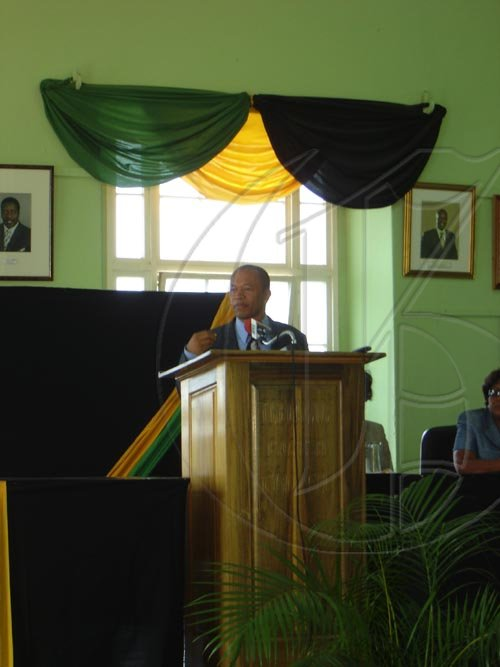 Dr. Patrick Harris, member of Parliament for North Trelawny, gives brief greetings to the Governor-General at the Parish Council Town Hall in Falmouth on Tuesday. The Parish Council was the first stop on the Governor-General's tour of Trelawny.