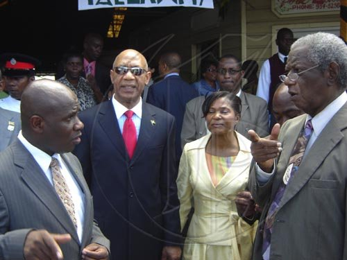 Standing outside the entrance to the Albert George Market and Shopping Centre, from left to right: Colin Gager, mayor of Falmouth; His Excellency the Most Honourable Sir Patrick Allen; Her Excellency the Most Honourable Lady Allen; Roylan Barrett, Custos Rotulorum of Trelawny.