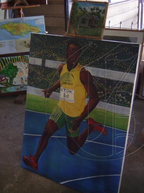 Usain Bolt's portrait is one of the many cultural items on display in the Albert George Market and Shopping Centre in Falmouth, Trelawny.