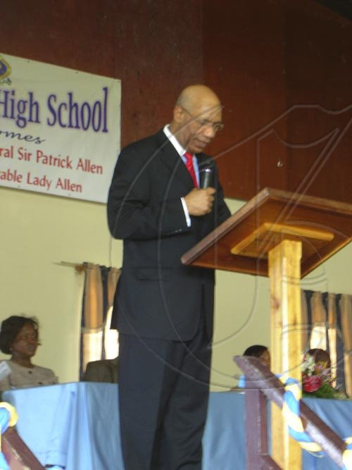The Governor-General, Sir Patrick Allen, addresses the Westwood High School populace during his visit there on Tuesday. The visit to the school was part of his scheduled tour of the parish of Trelawny.