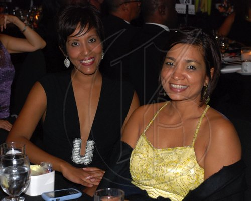 Colin Hamilton/Freelance Photographer PSOJ Hall of Fame on December 7, 2010 - At left, Nasma Mohammed and Denise Williams (PR Manager - Flow)