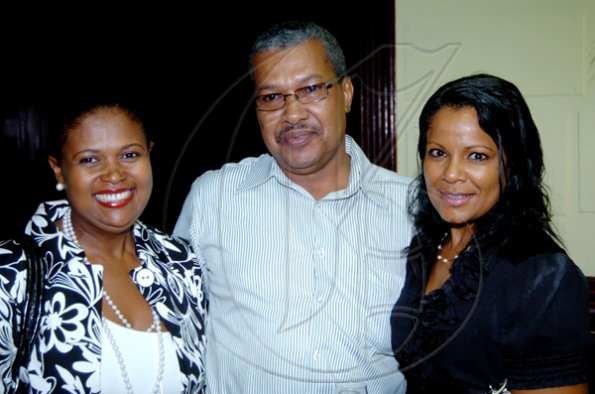 Winston Sill / Freelance Photographer Dollis Campbell (left), James Powell and Vitra Gopee are among the guests to bid Rosheuvel farewell.      Hilton Kingston Hotel host Farewell Reception, held at Hilton Hotel, New Kingston on Tuesday night June 29, 2010. .