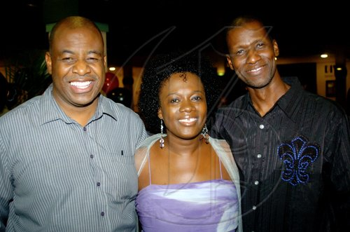 Winston Sill / Freelance Photographer Writer/producer of Hush 2, Marcia Weekes hangs out with Reverend Percival Palmer (left), general secretary of the Students Christian Fellowship and Scripture Union and Dave Weekes, executive producer of the movie.  ******************************************************************** Cocktail Reception for the premiere showing of the movie Hush 2, held at Palace Cineplex, on Tuesday February 23, 2010.